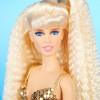Mattel trasforma Claudia Schiffer in una Barbie vestita Versace