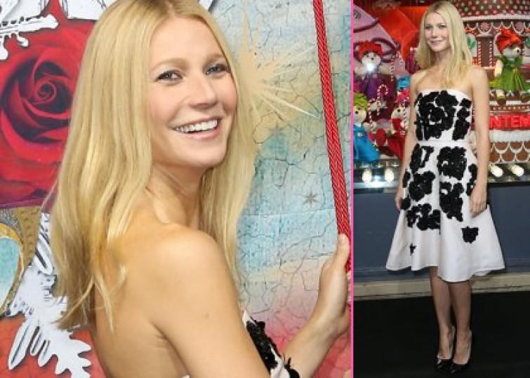 Gwyneth Paltrow indossa un abito Prada per l'inaugurazione del maxistore Printemps