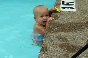 Baby-Swims-Across-Pool