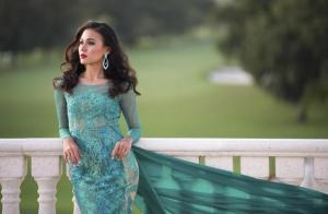 Miss Myanmar 2014 Eaindra poses in her evening gown at the 63rd annual Miss Universe Pageant in Miami